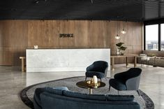PDG, Melbourne designed by Studio Tate, features an elegant seating area complete with coffee bar.