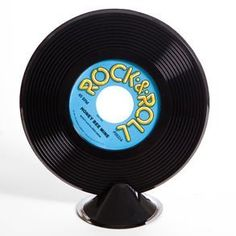 """Plastic Record Centerpiece by Century Novelty. $2.95. Music Decorations Spice up the Party! The music record centerpiece is the perfect addition to your rock and roll party decorating. No matter what your event these music decorations will be sure to make it a hit. 9 1/2"""" tall. Record on mini black stand. Made of plastic. Music decorations like these are perfect for school dances, Elvis or Blues Brothers parties and any """"rock and roll"""" event. Part of Decorations > Centerpieces"""