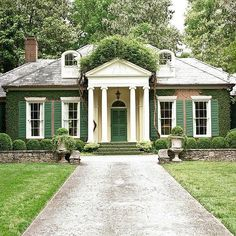 I love this house! The large shutters, brick, lovely column entrance, ivy, I could go on.. it's so charming!