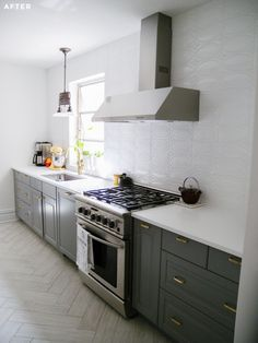 Brooklyn kitchen and bath renovation. Ikea kitchen with faux bois herringbone tile floor, range hood from Home Depot and salvage stove. From Sweeten.