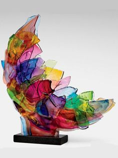 """Echo"" by Caleb Nichols - This breathtaking piece is created from blown glass forms that have been deliberately broken, then recombined and fused together into a kaleidoscopic sculpture that glows in the light."