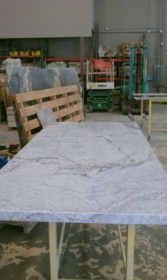 River White granite island in our shop being fabricated.  Great alternative to white marble for a kitchen!