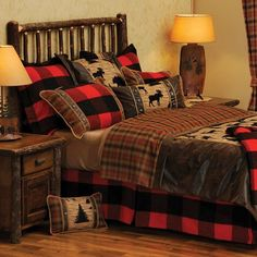 The Woodsman, log cabin bedding blends various plaids and faux leather fabrics, using a patchwork plaid featuring moose, dear, wolves and trees.  Made in the USA!