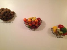 Those outdoor wall planter boxes repurposed to be a fruit/veggie bowl on your wall!! very cute!