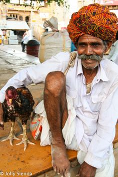 Portrait of a Indian man with his chicken, Jaisalmer, India. Photo by Jolly Sienda Photography.