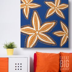 """Cold weather got you missing the beach? Try bringing some of the ocean home with you with """"Starfish Orange On Blue"""" by Kate Nelligan at GreatBIGCanvas.com."""