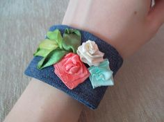 0547b38be3138 Bracelet on the hand decorated with flowers from ribbons and Ribbons