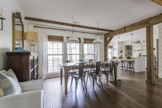 Love this open floor plan with big farmhouse table, metal chairs and enamel pendant lights eclecticallyvintage.com: