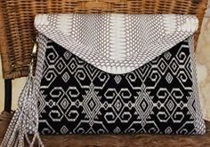 Pahikung Ikat and snakeskin clutch  Size 30x17 cm  IDR 450.000/USD 45