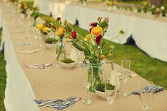 Google Image Result for http://cache.elizabethannedesigns.com/blog/wp-content/uploads/2009/12/rustic-wildflower-table-wedding.jpg
