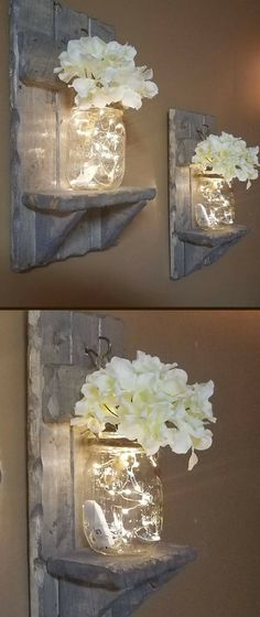 In love with these beautiful sconces! These mason jars, with firefly lights, twinkle on the stained shelves for the perfect Rustic Home Decor Accent....love!! #FarmhouseLivingRoom #HomeDecorIdeas #LivingRoomDecor #affiliate #RusticHomeDecor #MasonJar #HouseWarmingGift #Sconces #BridalShowerGift