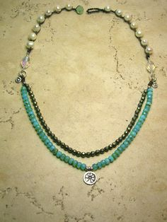 Crocheted jewelry - aqua beads, Thai silver charms, freshwater pearls and pyrite