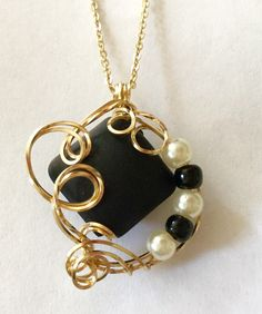 A personal favorite from my Etsy shop https://www.etsy.com/listing/480875753/striking-black-stone-gold-filled-wire