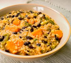 Quinoa Sweet Potato Black Bean Stew: With cooked quinoa and black beans, this gluten free, hearty and spicy vegan recipe is ready to eat quickly.  This quinoa black bean recipe takes 4 - 5 hours in a slow cooker. If you need to be away longer, an inexpensive digital timer is handy, so supper is ready when you are.