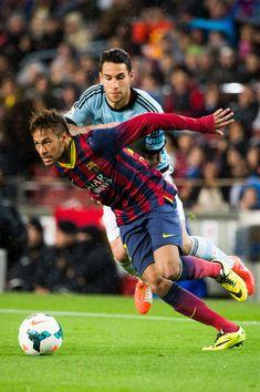 Neymar Santos Jr of FC Barcelona fights for the ball with Hugo Mallo of RC Celta de Vigo during the La Liga match between FC Barcelona and RC Celta de Vigo at Camp Nou on March 26, 2014 in Barcelona, Catalonia.