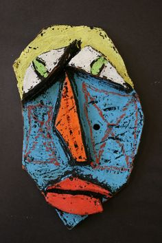 Fourth grade mask inspired by artist Kimmy Cantrall. Embellished with oil pastel and black tempra.