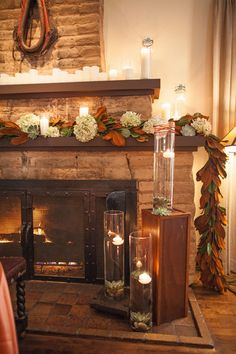 Set inside The Wigwam's Fireplace Lounge-original to the resort-the design concept was crafted from the resort's rich history as an Arizona treasure and strived to create a warm, intimate feeling in front of the resort's original 1918 fireplace that was adorned with a magnolia leaf garland and numerous flickering candles. Venue: The Wigwam Photography: LindenLeaf Photography Floral Décor: Thee Wedding & Event Warehouse Rentals : Classic Party Rentals