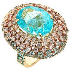 13.20cts of Paraiba tourmaline (15.76 x 11.93mm) 1.87cts of G-H color white diamonds 1.62cts of round Paraiba tourmalines 18k yellow gold