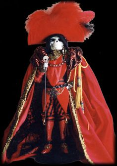 Mask of the Red Death Phantom doll with glowing red eyes. Spooky!