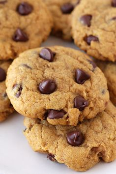 These Pumpkin Chocolate Chip Cookies are soft yet chewy, not at all cakey like most pumpkin cookies! These are loaded with spices and are a HIT every fall. Baked Pumpkin, Pumpkin Recipes, Cookie Recipes, Pumpkin Pumpkin, Pumpkin Puree, Dessert Recipes, Yummy Treats, Sweet Treats, Pumpkin Chocolate Chip Cookies