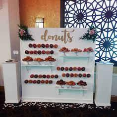 Large free standing donut wall holding up to 194 donuts. Supplied with the plinths for use as server/serviette stands or use along with our tiered cake stands for even more fresh donut displays. Fresh flower arrangements to your chosen colour scheme upon request.