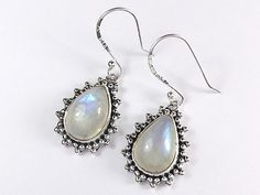 Gorgeous rainbow moonstone gemstone glows with elegance nestled between stunning sterling silver teardrop earrings with beautiful victorian style designs.