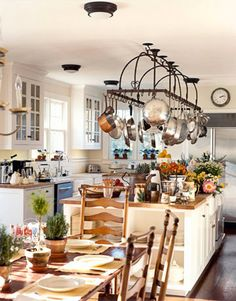 Designer Robin Bell knows the importance of a big, dynamic kitchen island. For this New York cottage she opted for a piece that had bonus storage on the sides and an extensive pot rack on top. New Kitchen, Vintage Kitchen, Kitchen Dining, Kitchen Decor, Kitchen Ideas, Long Kitchen, Happy Kitchen, Family Kitchen, Kitchen Pictures