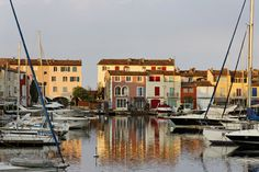 """Lakeside town nestled in the Gulf of Saint-Tropez, Grimaud owes its charm to its canals and small bridges and marina which can accommodate 250 moorings which earned it the nickname """"Venice of Provence"""". Port Grimaud is registered with the label """"Heritage of the twentieth century"""" since 2001."""