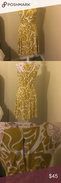 Bar III Dress Beautiful Flowing Bar III dress. Like new. Worn one time.  Mustard and white swirls on this dress. Beautiful for work with a cardigan or without with sandals. Size XL BUT FITS LIKE a 6/8. Bar III Dresses