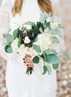 hydrangea and eucalyptus bouquet - photo by Ann-Kathrin Koch http://ruffledblog.com/british-wedding-on-the-english-seaside #weddingbouquet #bouquets