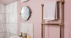We take a tour of Hayley Caradoc-Hodgkins' Victorian renovation in South London. They moved in nine months ago and have since revamped and spruced the entire house, opting for luxe marble-clad interiors throughout. Their home is flooded in natural light and they've incorporated a muted colour palette from top to bottom. Here you can see their gorgeous bathroom in powder pink.