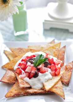 Dessert Nachos -- cinnamon sugar tortillas with whipped cream, strawberries and nutella