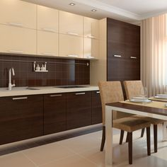 Contrasting kitchen cabinetry complements a classic dining table.
