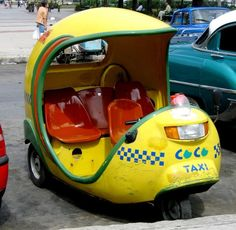 "One of the most peculiar means of transport in La Havana is the ""Coco Taxi"". The coco taxis are motorcycle-taxis, which have the appearance of a yellow coconut match by half. These vehicles which can bring one or two persons are very comfortable, speed and costs the same as regular taxis"