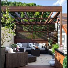 Nice contemporary outdoor pergola/shade structure. Wood framing, add a shade cloth for more sun protection.