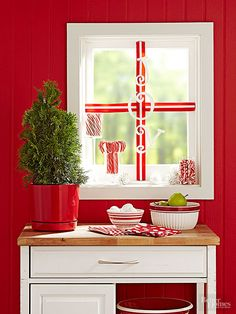 20-Minute Holiday Decor: Criss-cross pretty ribbon across a plain window frame, tacking or taping the ends to secure.  Hang decorative wood letters from the ribbon with double-stick tape.  Add a few glass jars of coordinating candy to the windowsill.