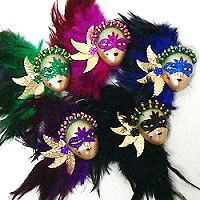 Face magnets make attractive Carnival souvenirs for gift shops.  The same face magnets are popular Mardi Gras favors for members of Krewes attending the Ball.  These masked face magnets have satin gold ceramic faces with glittery masks and feather trim in five colors.  Pick from 22 different styles of face magnets for your customers that want souvenirs or Mardi Gras favors. http://www.awnol.com/store/Mardi-Gras/Mardi-Gras-Magnets