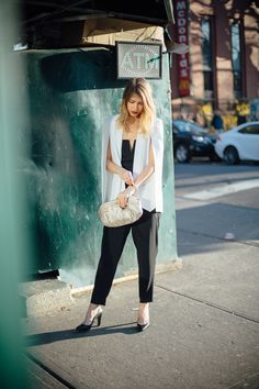 black jumpsuit white cape