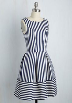 Sure, this striped A-line by Closet London is the essence of country club chic, but when worn along the coast, it's aesthetic adopts a nautical twist! Textured navy stripes and a pleated skirt give this dress serious shoreline appeal, while its golden zipper and pockets are features you simply must 'sea' for yourself!