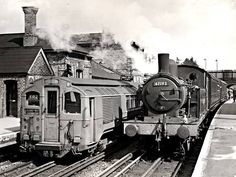Steam and electric powered trains at Epping Underground station - London
