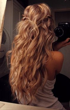 My mom is thinking of doing a perm on my hair since it's long and really pretty, it would look like this (: