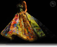 Epic Gown Made Out Of Little Golden Books. Designer Ryan Novelline has made fairytale dreams become a reality by sewing a dress completely covered in Little Golden Book . Front view. The bodice is made from the books' foil spines!