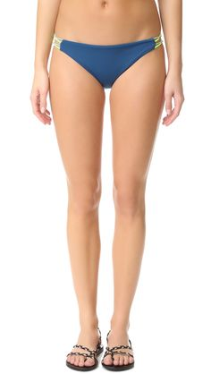 Buy it now. Basta Surf Zunzal Reversible Bungee Bottoms - Blu Tropico. Reversible Basta Surf bikini bottoms with skinny elastic bands at the sides. Double layered. 80% nylon/20% spandex. Hand wash. Made in the USA. Size & Fit. Available sizes: M , bikini, bikini, biquini, conjuntosdebikinis, twopiece, trisuit. Light blue Basta Surf  swimsuit  for woman.