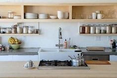 love the solid box-like open shelving. would want this under closed uppers.