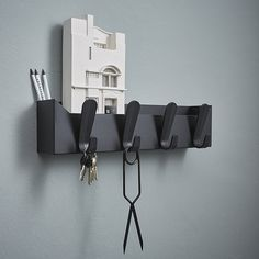The Krok series of coat hooks excels in simplicity. Designers Mia Lagerman & Ehlén Johansson have reduced the design to its very essence.  Krok Box is a smart wall mounted coat rack and storage box in one. The epoxy-coated steel box with plastic hooks offers useful extra space for items such as keys and mail. Krok Box can be mounted on timber, brick or concrete with the two black screws supplied. Available in seven colours…