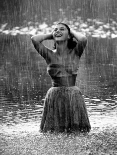 Image result for photos of women caught in the rain