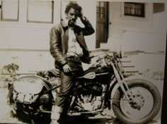Early Black Biker-- lookin' rough & ready. Love his crazy hair, cool belt and rolled-up selvedge jeans.