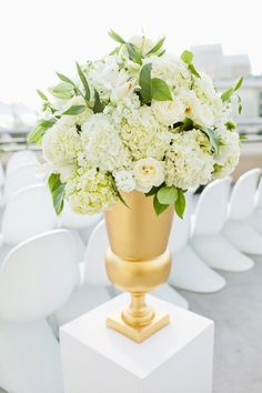 Love the classic feel to this floral arrangement in a modern setting. See the wedding on SMP: http://www.StyleMePretty.com/2013/01/22/san-diego-rooftop-wedding-from-birds-of-a-feather-photography/ Birds of a Feather Photography
