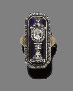 A blue glass and diamond mourning ring, circa 1800 The rectangular blue glass plaque applied with a central rose-cut diamond urn motif. Old Jewelry, Hair Jewelry, Antique Jewelry, Vintage Jewelry, Fashion Jewelry, Jewlery, Mourning Ring, Mourning Jewelry, Memento Mori