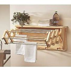 this pull out drying rack is unfinished so can be painted to blend in.